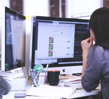A girl sitting and working infront of computer
